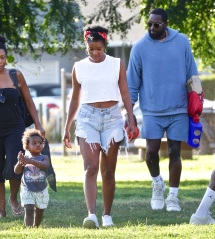 EXCLUSIVE: NBA superstar Dwyane Wade and Gabrielle Union spend the day at the park with daughters Zaya and Kaavia. The family spent the day at a Los Angeles park where they played horseshoes and baseball. Zaya hit a homer at one point and were later seen celebrating. Gabrielle Union also was seen with noticeably shorter hair for the outing. **SPECIAL INSTRUCTIONS*** Please pixelate children's faces before publication.***. 11 Jul 2020 Pictured: NBA superstar Dwyane Wade and Gabrielle Union spend the day at the park with daughters Zaya and Kaavia. Photo credit: ROMA / MEGA TheMegaAgency.com +1 888 505 6342 (Mega Agency TagID: MEGA688003_001.jpg) [Photo via Mega Agency]