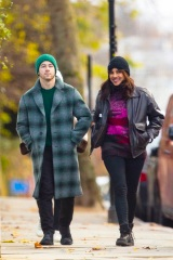 EXCLUSIVE: Nick Jonas and wife Priyanka Chopra Jonas go sightseeing around London ahead of the Christmas holidays. The couple, who have been married for two years, wore face masks and stopped for a hot drink at a cafe. The Bollywood actress who is in town to film 'Text for You', looked positively glowing. The happy couple could be seen stopping for Nick to take some funny photos of Priyanka next to a Highway Maintenance van, presumably to have the words 'High Maintenance' behind her. The loved up pair could be seen walking along with Priyanka's mother in tow, always a couple of yards behind them. Nick, 28, and Priyanka, 38, could be seen wearing Christmas colors, with Nick in a green beanie hat and green accented checked woolen overcoat, while Priyanka opted for a dark brown leather jacket with red and pink knitted top, beanie hat, and jeans. 09 Dec 2020 Pictured: Nick Jonas, Priyanka Chopra Jonas. Photo credit: MEGA TheMegaAgency.com +1 888 505 6342 (Mega Agency TagID: MEGA720310_003.jpg) [Photo via Mega Agency]