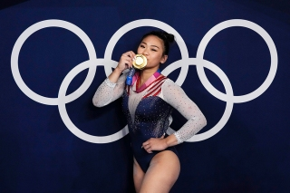 Sunisa Lee, of United States, reacts as she poses for a picture after winning the gold medal in the artistic gymnastics women's all-around final at the 2020 Summer Olympics, in Tokyo, Japan Olympics Artistic Gymnastics, Tokyo, Japan - 29 Jul 2021